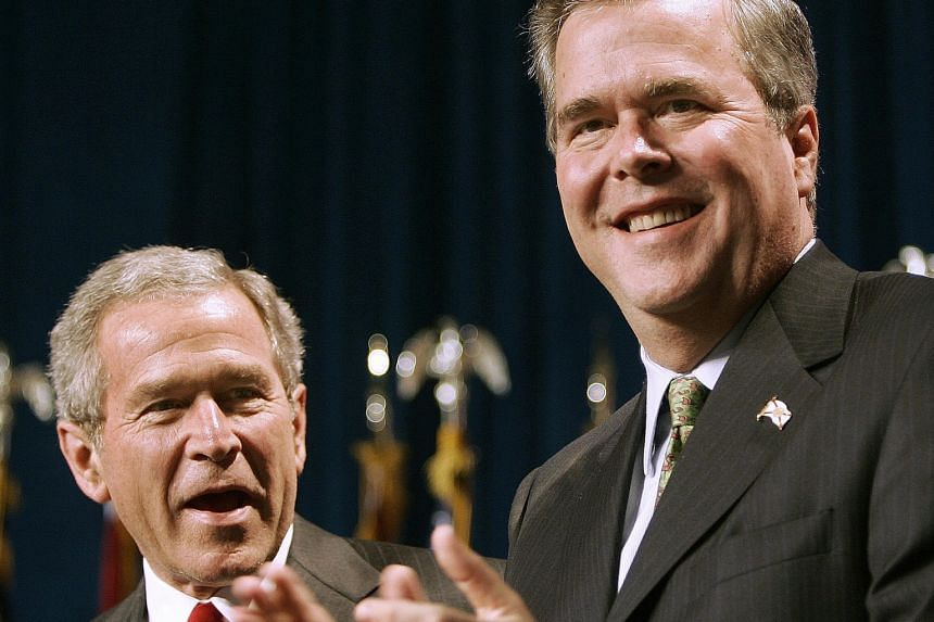 Republican presidential hopeful Jeb Bush (right) with his brother, former president George W. Bush, in a 2006 photo.