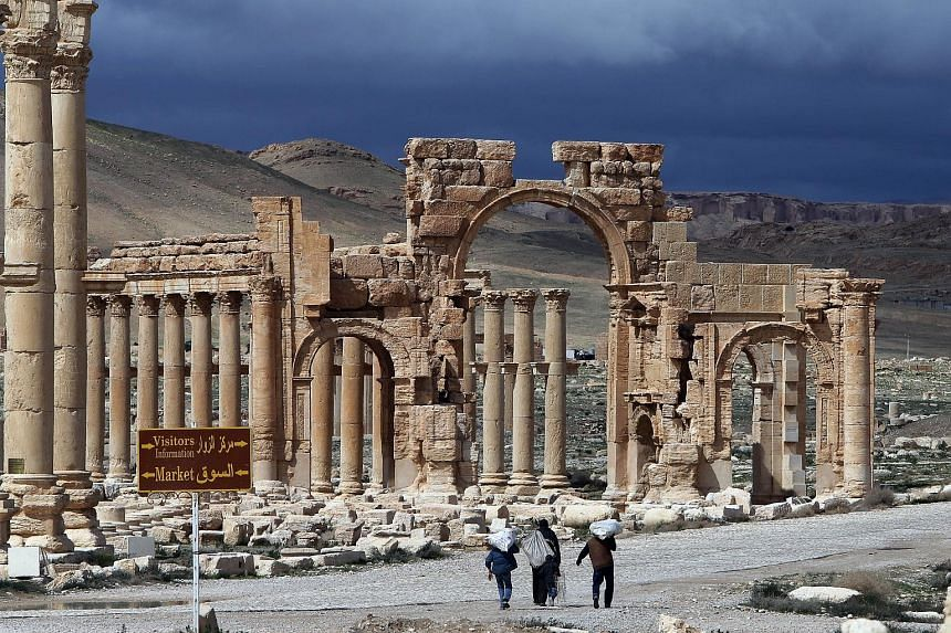 A picture taken on March 14 last year of Palmyra's famous Arch of Triumph, which ISIS militants are said to have destroyed on Sunday. Syrian antiquities director Maamun Abdulkarim warned of a catastrophe at the Unesco-listed World Heritage site and s