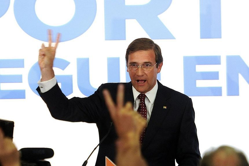 Portuguese Prime Minister Pedro Passos Coelho celebrating after securing victory in Portugal's general election on Sunday.