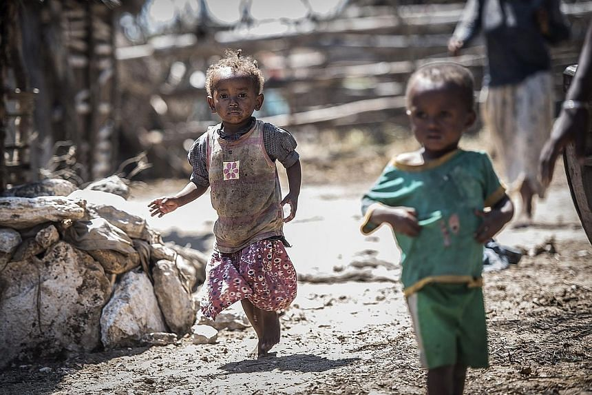 Children in a village in Ambovombe, southern Madagascar. Despite the improved figures on poverty, countries such as Madagascar and the Democratic Republic of Congo have been singled out in the World Bank report as particularly worrisome instances of