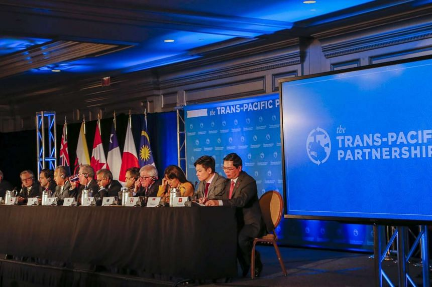 Trade ministers from the 12 Trans-Pacific Partnership (TPP) member countries at the closing press conference in Atlanta on Oct 5.