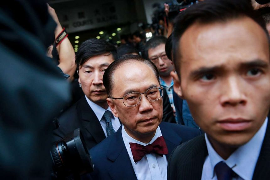 Donald Tsang, Hong Kong's former chief executive (centre) leaving the Eastern Magistrates' Court in Hong Kong on Oct 5.