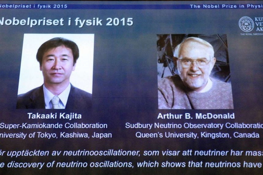 The portraits of Dr Takaaki Kajita (left) of Japan and Dr Arthur McDonald are displayed on a screen during a press conference to announce the winner of the 2015 Nobel Prize in Physics, at the Swedish Academy of Sciences in Stockholm on Oct 6, 2015.