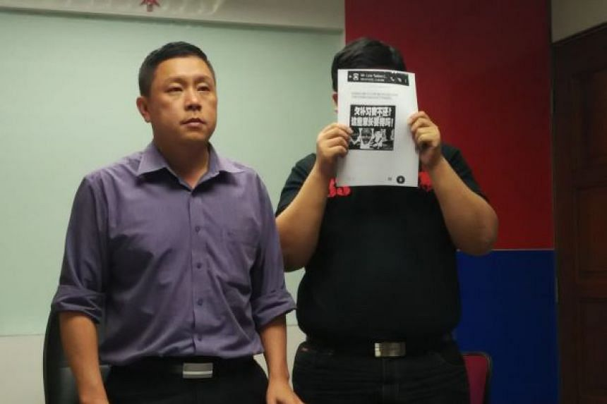 Balakong assemblyman Eddie Ng (left) with Mr Low, who runs the tuition centre.