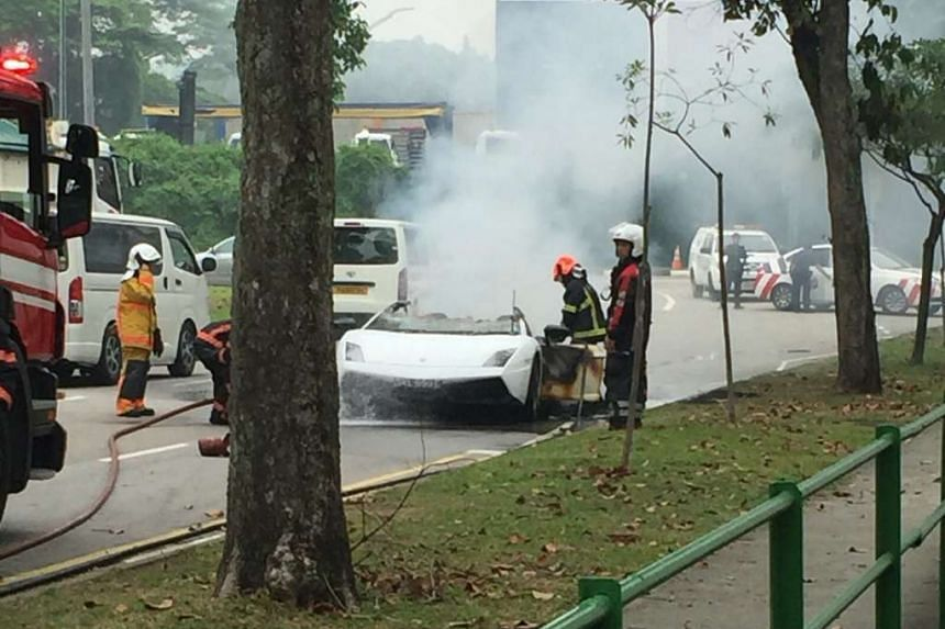 SCDF officers putting out the fire in the Lamborghini.