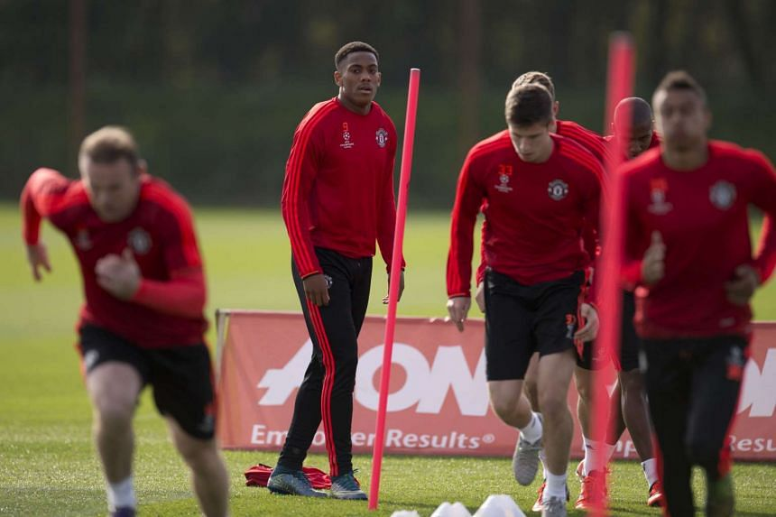 Manchester United's French striker Anthony Martial (second, left) taking part in a team training session on Sept 29, 2015.
