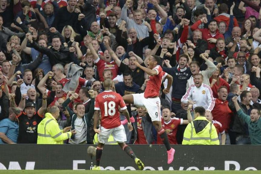 Manchester United's French striker Anthony Martial (right) celebrates scoring for his new team.