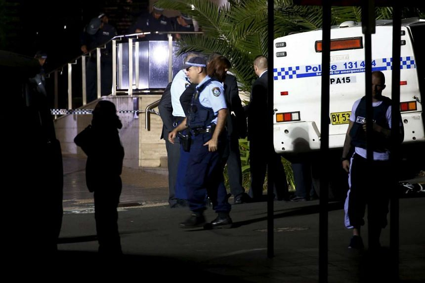 Police inspect and guard the area outside the New South Wales state police headquarters located in the south western Sydney suburb of Parramatta, Australia, Oct 2, 2015. A student who attended the same school as a teenager who shot dead a man outside