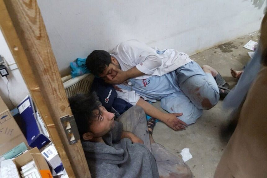 A handout provided by Medecins Sans Frontieres (MSF) shows the Doctors Without Borders staff in shock in one of the remaining parts of the hospital in Kunduz in the aftermath of the bombings on Saturday.