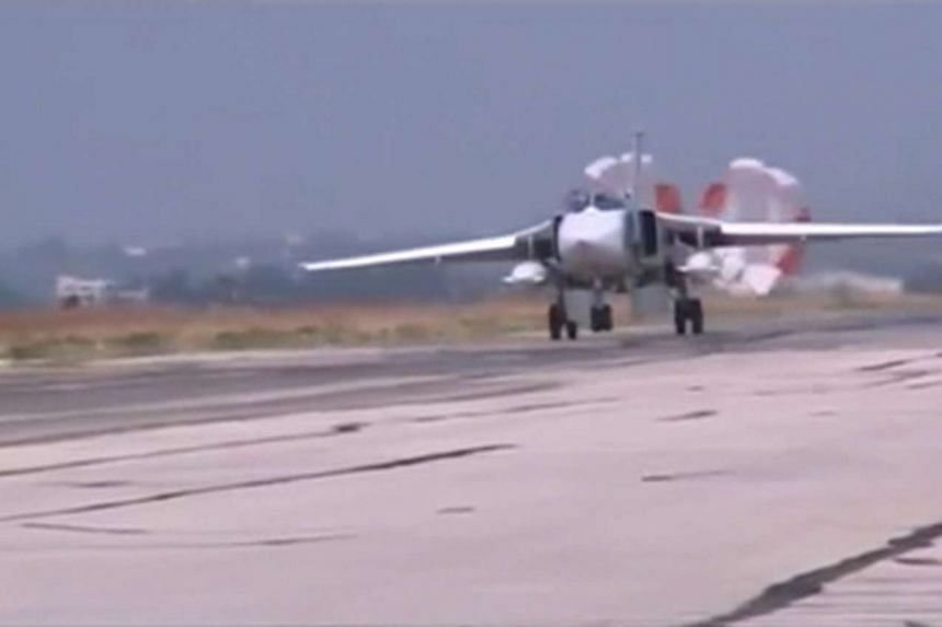 An image from video footage released by Russia's Defence Ministry on Monday shows a Russian air force Su-24 military jet slowing down after a sortie, at Heymim air base in Syria.