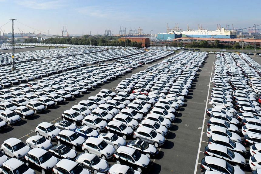 New cars are parked ready for shipping from Germany, as the Volkswagen admitted more pollution-cheating..
