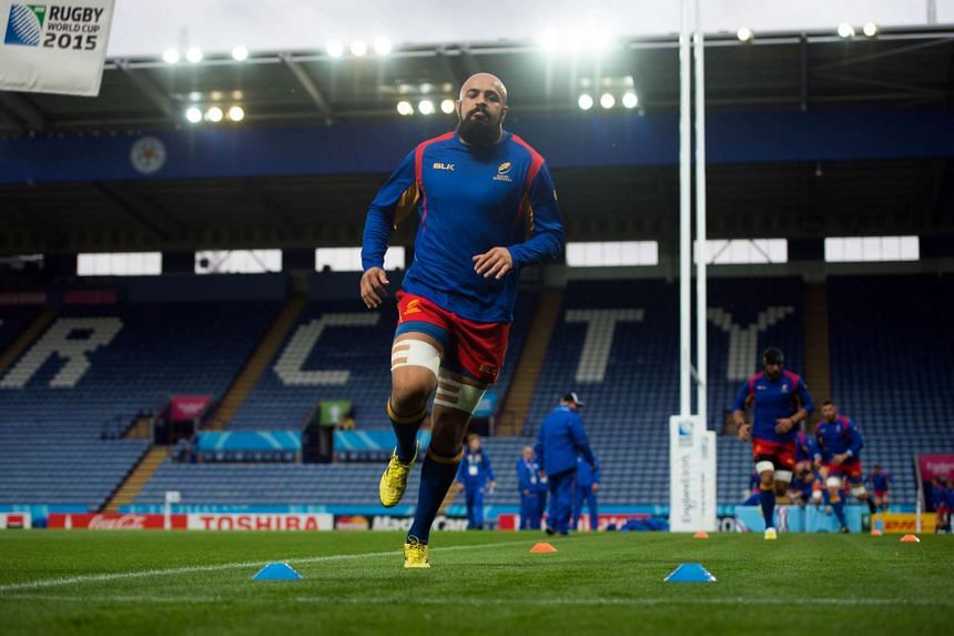 Romania's back row forward Viorel Lucaci taking part in a training session in Leicester on Oct 5, the eve of the Rugby Union World Cup match against Canada.