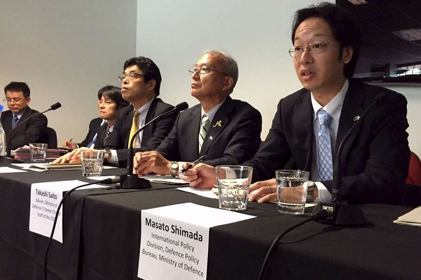 Mr Takashi Saito (second, right), head of a Japanese consortium eyeing one of the world's most lucrative defence contracts, speaking at a news conference in Adelaide, South Australia in this Aug 26, 2015, file photo.
