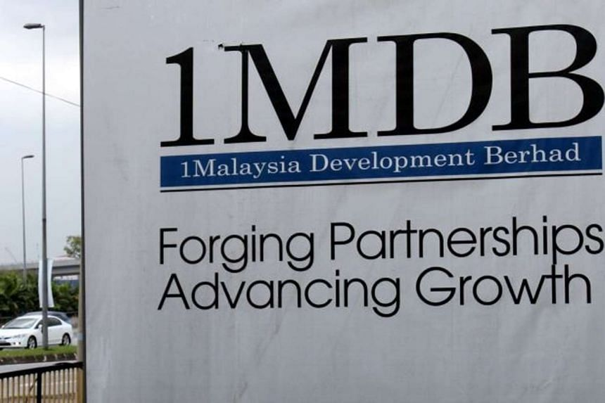 A billboard with the 1 Malaysia Development Berhad logo at the funds flagship Tun Razak Exchange construction site in Kuala Lumpur on Sept 22, 2015.