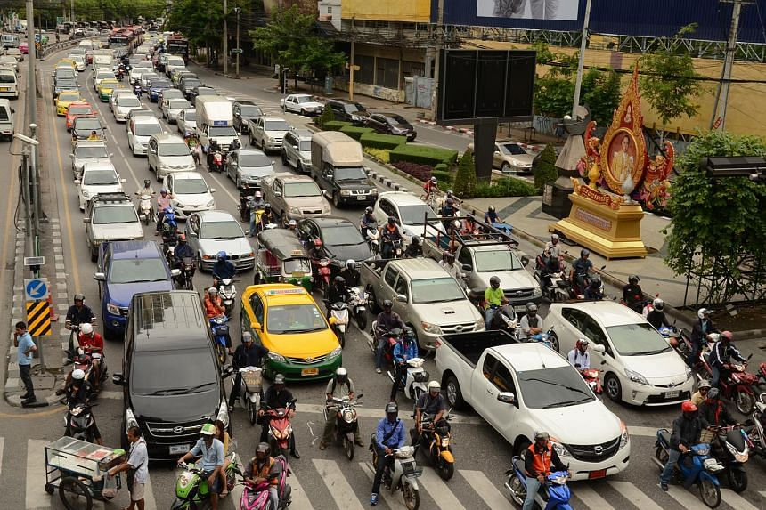 Traffic along the Ratchadaphisek Road, a major thoroughfare in Bangkok, Thailand, on a typical afternoon.
