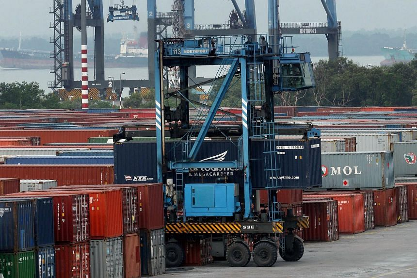 Shipping containers are stacked at North Point in Port Klang, Selangor, Malaysia, on Feb 27, 2010.