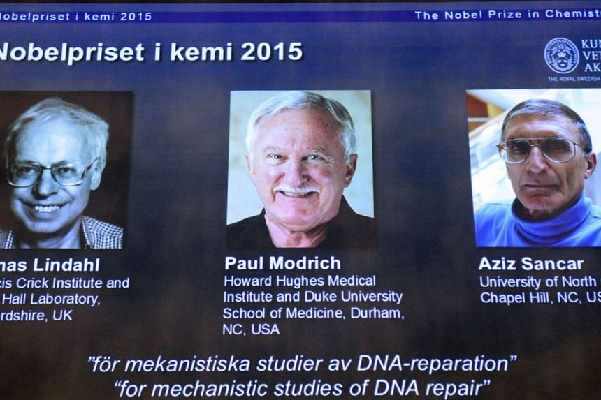 The portraits of the winners of the Nobel Prize in Chemistry 2015 (from left) Sweden's Tomas Lindahl, Paul Modrich of US and Turkish-American Aziz Sancar are displayed on a screen during a press conference on Oct 7, 2015 at the Royal Swedish Academy