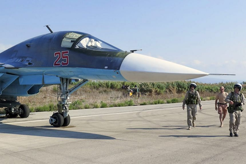 Russian pilots of SU-34 bomber checking their plane before the flight at the Syrian Hmeymim airbase, outside Latakia, Syria.