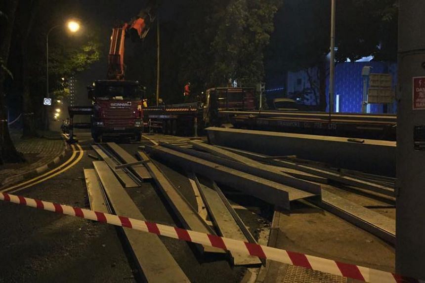 Metal i-beams lying on the road where a lorry almost toppled over, causing it to drop its cargo, on Oct 7, 2015.