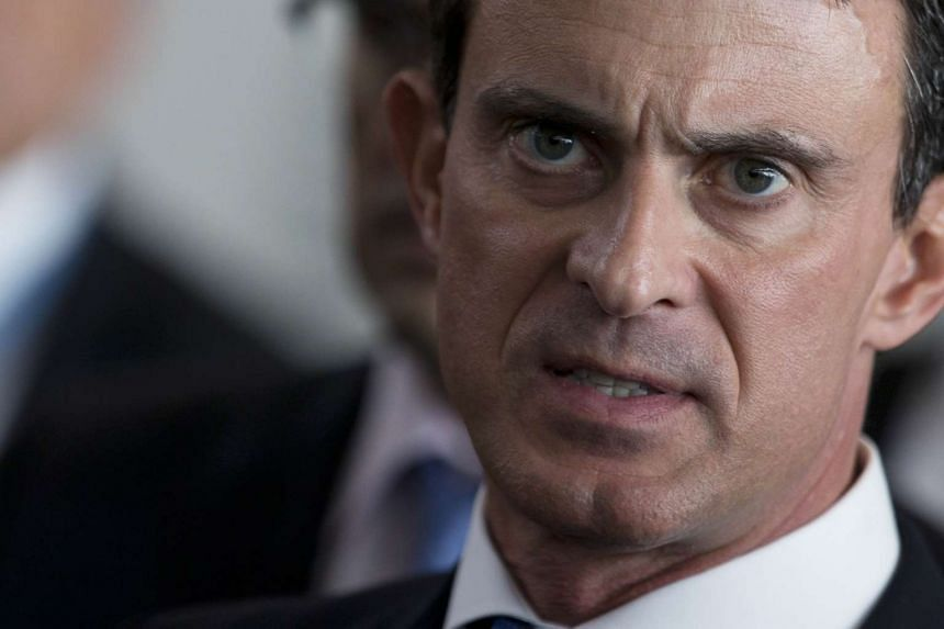 French Prime Minister Manuel Valls said he would stand by Air France in its bid to slash costs .