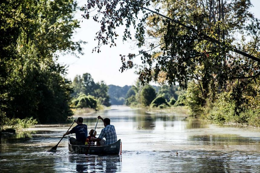 People canoe down South Beltline Road Oct 6, 2015 in Columbia, South Carolina.
