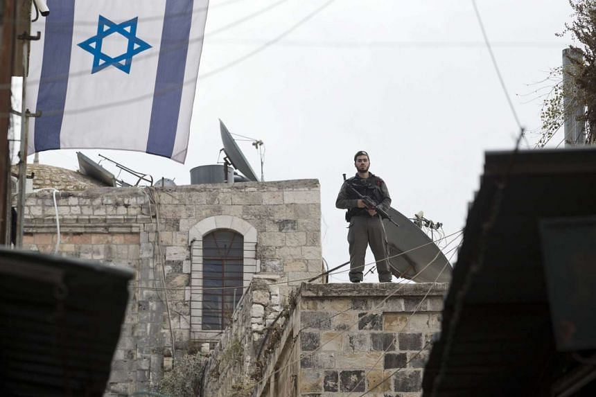An Israeli border police officer standing guard near the scene of an attack involving a Palestinian woman and Israeli man in the Old City of Jerusalem, on Oct 7, 2015.