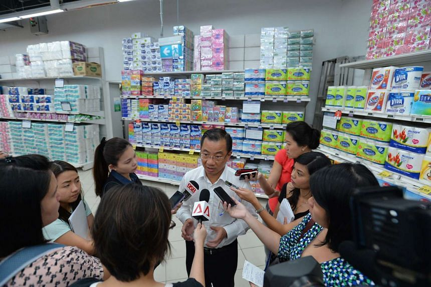 Mr Seah Kian Peng (centre), NTUC FairPrice executive director, said that FairPrice has been monitoring the situation over the past week.