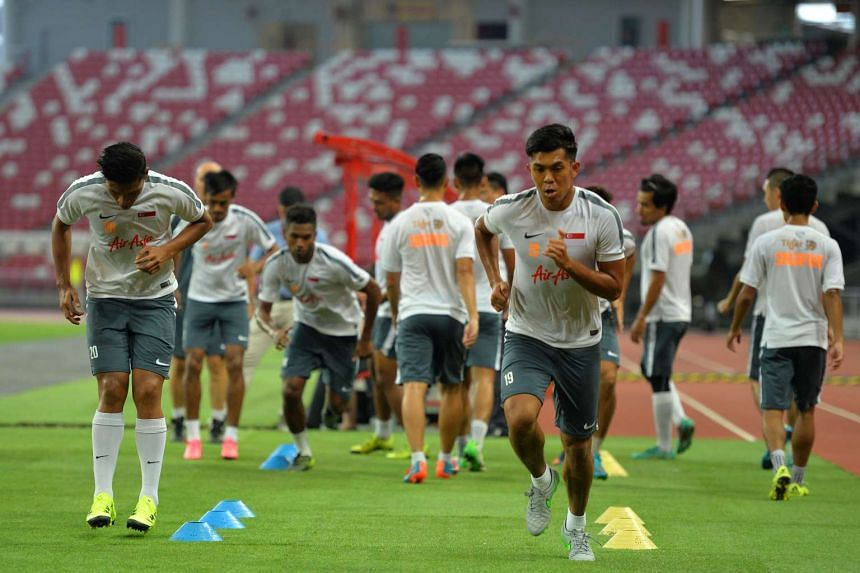 The national football team training at the National Stadium on Oct 7, 2015, ahead of the qualifier against Afghanistan.