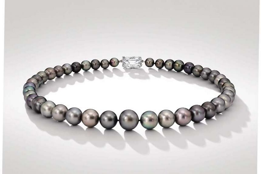 A rare grey pearl necklace, part of the collection of Viscountess Cowdray, Lady Pearson, was sold for HK$41 million (S$7.5 million) in Hong Kong on Oct 7, 2015.