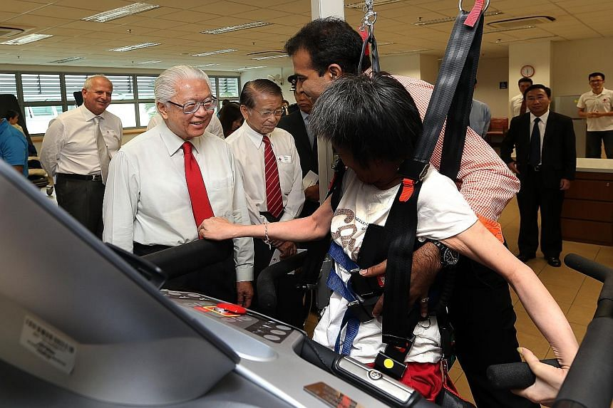 (From left): President Tony Tan Keng Yam, patron of the Singapore Red Cross, and Mr Tee Tua Ba, its chairman, at the Red Cross Home for the Disabled in Lengkok Bahru yesterday.