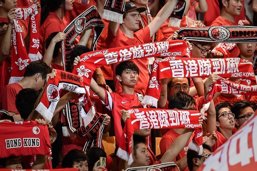 Football fans at the match between Hong Kong and Qatar last month. At the match, a carton of lemon tea was thrown at a Qatari player.