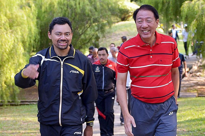 Mr Teo Chee Hean and His Royal Highness Crown Prince Al-Muhtadee Billah of Brunei having a morning walk at the Berakas Forest Reserve yesterday. Crown Prince Billah hosted DPM Teo and his delegation to breakfast thereafter.