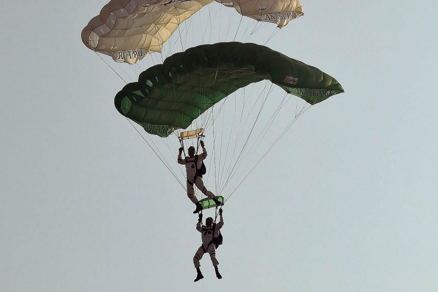 Indian Air Force paratroopers of the Akash Ganga team gliding in to land during a full-dress rehearsal for their Air Force Day parade at Air Force Station Hindon, in Ghaziabad town, on the outskirts of New Delhi, on Tuesday. The Indian Air Force will
