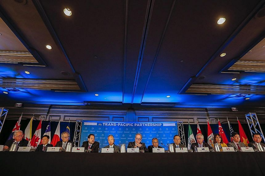Trade representatives from the 12 Trans-Pacific Partnership member countries at the closing press conference in Atlanta, Georgia, on Monday. Business chambers have lauded the TPP's special provisions that aim to help smaller enterprises integrate int