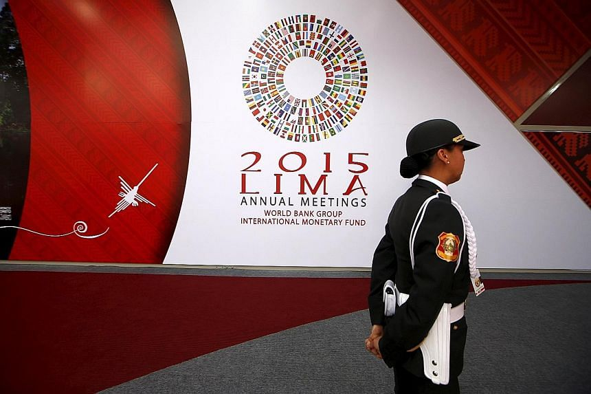 """A Peruvian policewoman at the venue of the IMF/World Bank meetings in Lima. The IMF advised emerging markets to be ready for the US to tighten monetary policy and urged advanced economies to address """"crisis legacies""""."""