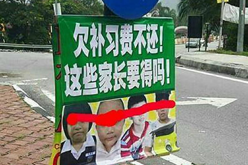 "The pictures of the children, with a Chinese banner that says: ""Owe tuition fees but refuse to pay up! Do they deserve such parents?"""