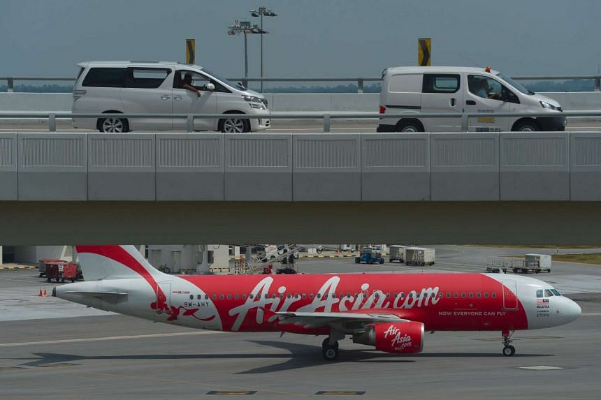 An AirAsia Airbus A320 airplane is seen on the tarmac preparing for departure at the low-cost carrier Kuala Lumpur International Airport 2 (KLIA2) in Sepang on Aug 20, 2015.