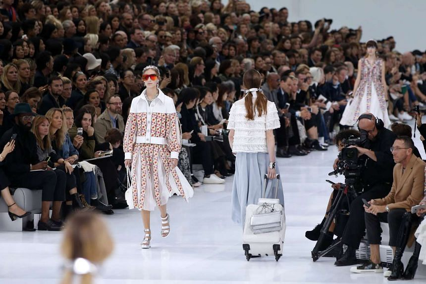 Models present creations for Chanel during the 2016 Spring/Summer ready-to-wear collection fashion show.