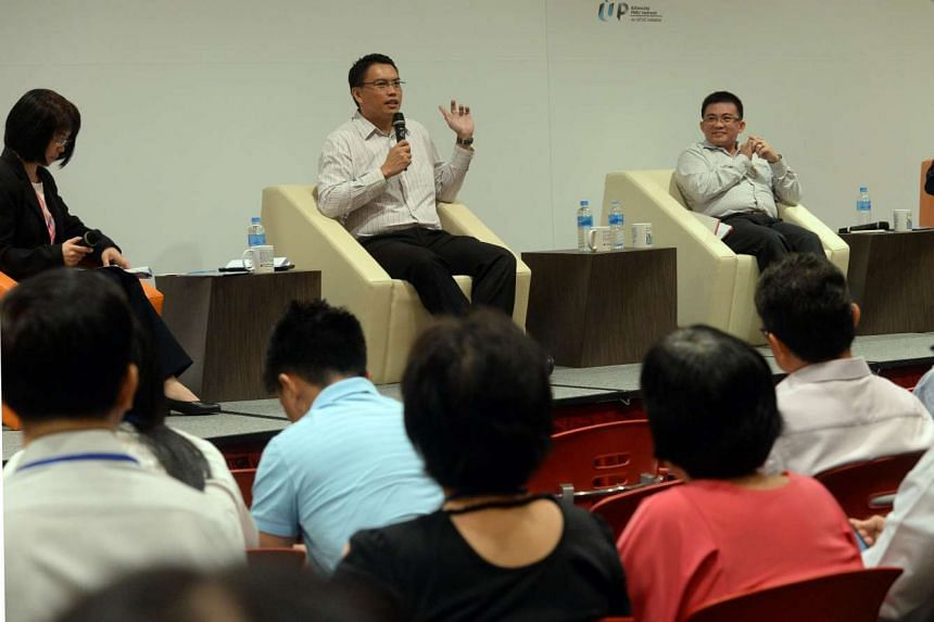 (From left) WDA deputy director of the career services division Ng May May, NTUC assistant secretary-general Patrick Tay, SNEF assistant executive director Stephen Yee and HR entrepreneur Adrian Tan (out of picture) speaking at the PME Learning and N