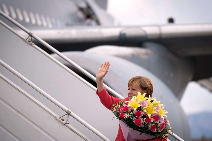 Nobel Peace Prize contender?: German Chancellor Angela Merkel  on the gangway to board her flight in Bangalore, India, on Oct 6, 2015.