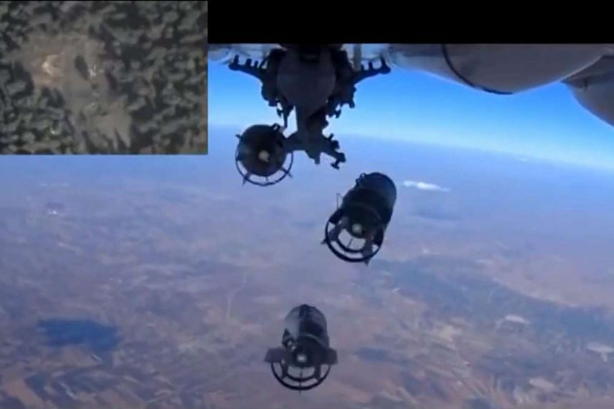 A frame grab from the official Russian Defence Ministry shows bombs  dropped by a Russian warplane during an airstrike in Syria.