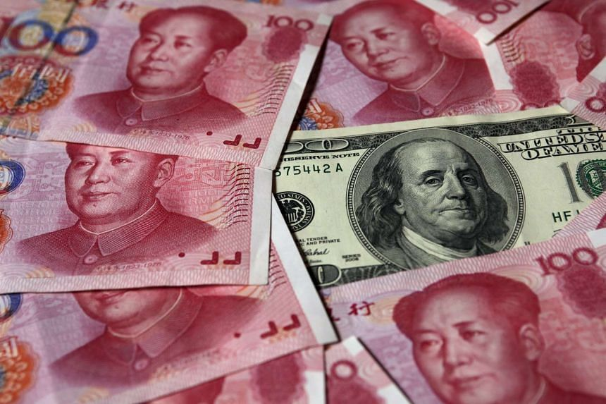 China's foreign-exchange reserves fell by a record last quarter as its central bank sold dollars to support the yuan.