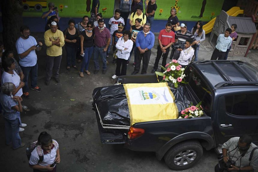 The coffins of nine-year-old Marielos Sanches and his brother Heison, 12, victims of October 1st landslide.