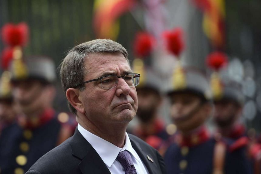 US Secretary of Defence Ashton Carter review troops in Madrid at the start of a five-day trip to Europe on Monday.