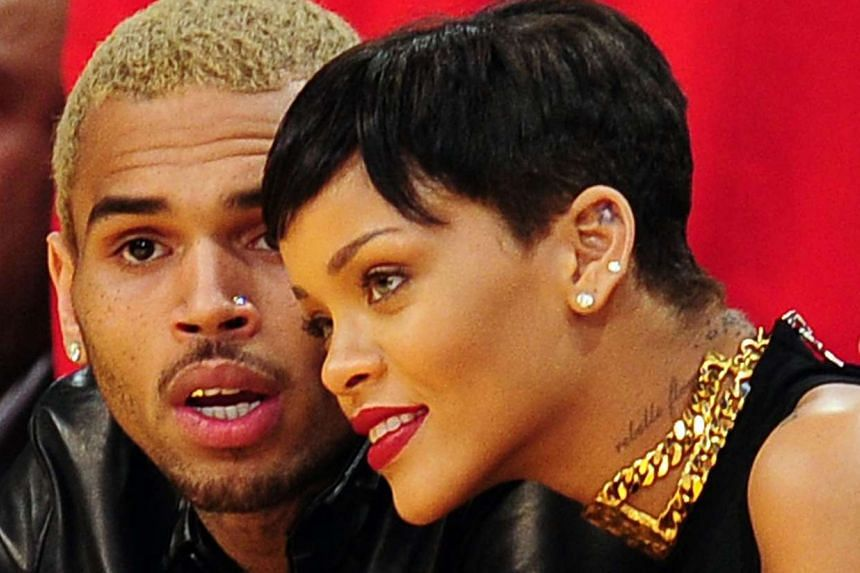 A 2012 file photo shows Rihanna (right) with her ex Chris Brown, who famously assaulted her in 2009.