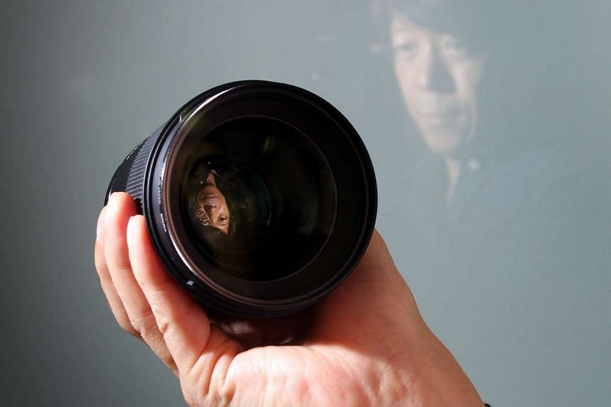 """Mr Kazuto Yamaki, CEO of Japanese camera and lens maker Sigma Corporation, says one way his privately-owned family business has managed to compete with the bigger players is by adhering to his father's philosophy of """"small office, big factory""""."""