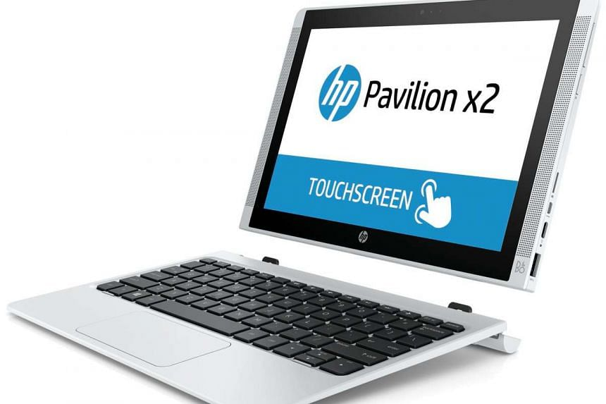 To transform the Pavilion x2 from a laptop into a tablet, simply use both hands to pull apart the screen and the keyboard.