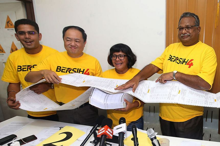 Bersih officials showing the media a bank statement containing the account numbers of about 27,000 people who had put in money to help the electoral reforms group organise a rally in August. The officials said the list was being audited independently.