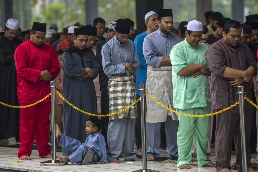 Muslims perform Eid al-Adha prayers at the National Mosque in Kuala Lumpur, Malaysia.