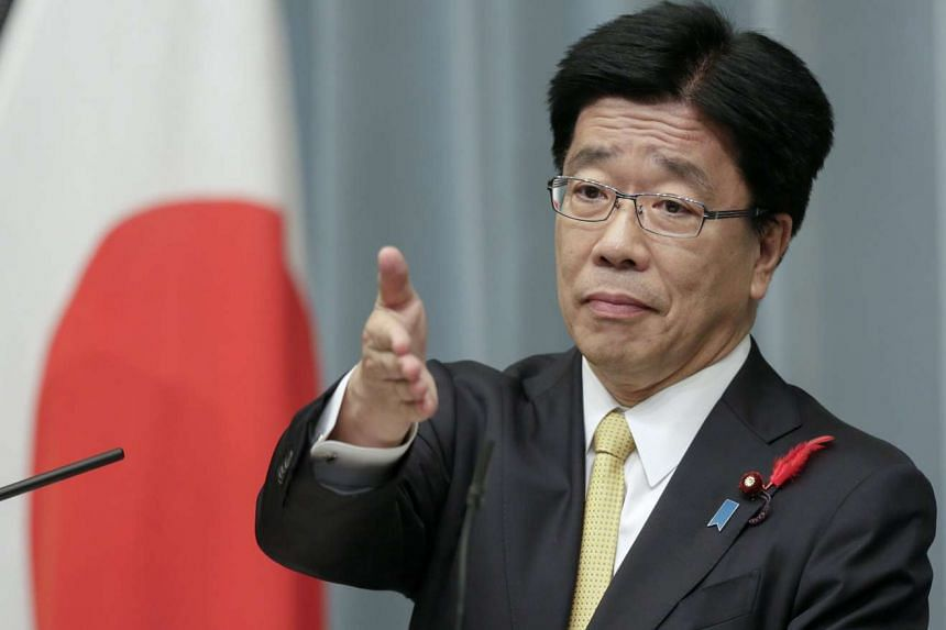 Newly appointed Japanese Minister in Charge of Promoting Dynamic Engagement of All Citizens Katsunobu Kato speaks during a news conference at the prime minister's official residence in Tokyo on Oct 7, 2015.